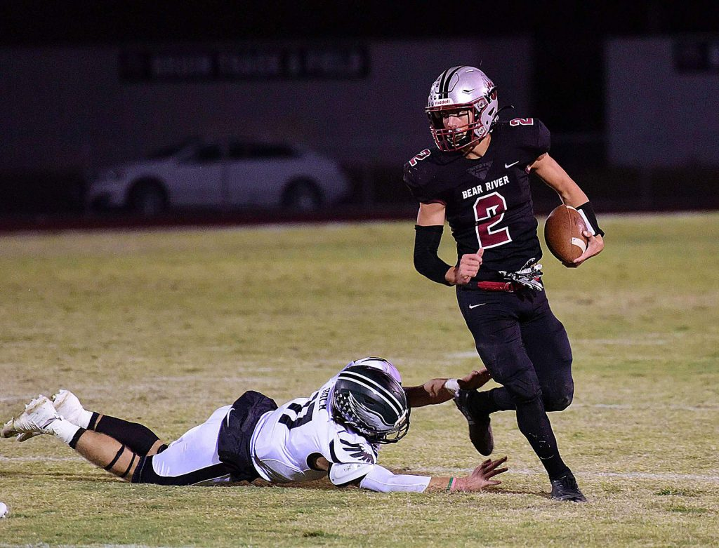 Bear River's Colton Jenkins looks for running room during a game against Colfax Friday night at J. David Ramsey Stadium.