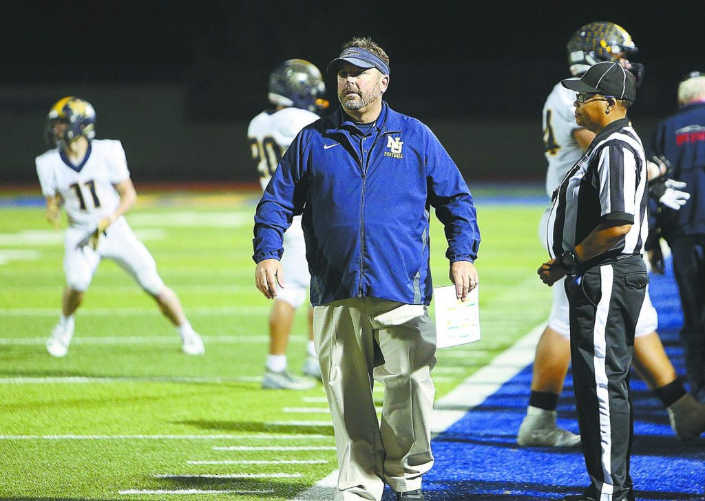Nevada Union Miners varsity head coach Brad Sparks walks the sideline during Friday night's game against the Lincoln Fighting Zebras.