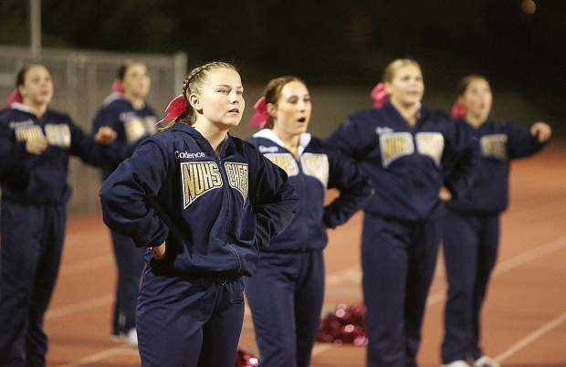 The Nevada Union cheerleaders watch their team as they attempt to score during Friday's matchup against the Oakmont Vikings.