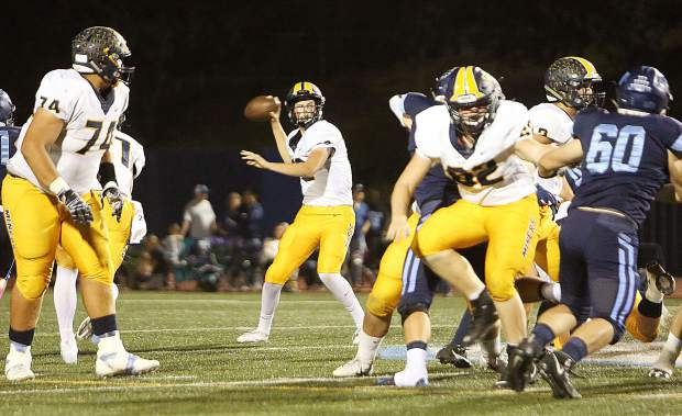 Miners' varsity quarterback J.T. Conway readies to throw a pass during Friday's away game against the Oakmont Vikings.