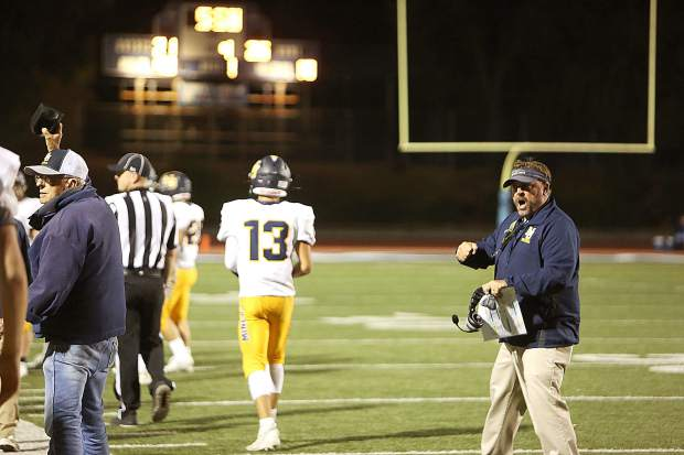 Nevada Union varsity head coach Brad Sparks gets pumped up after a play by the Miners.