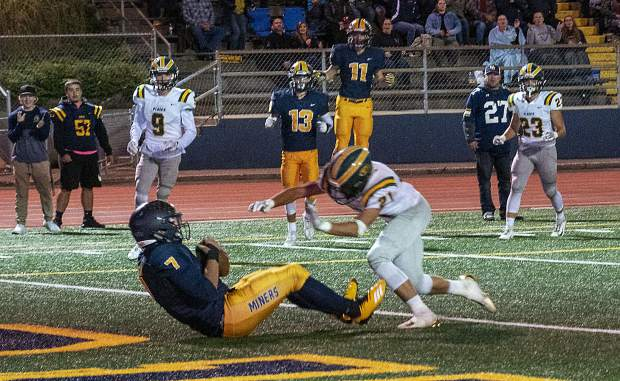Nevada Union's Matt Dal Bon huals in a touchdown pass during a game against Placer Friday night at Hooper Stadium.