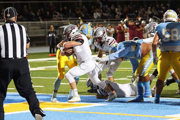 Bear River's Ryder Kiggins charges into the end zone during a game against Center last week. Kiggins and the rest of the Bruins face off against Lindhurst tonight oin Olivehurst.