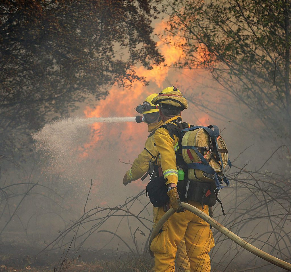 Firefighters progress into the Dorsey Fire Sunday afternoon off of Dorsey and Sutton Way.