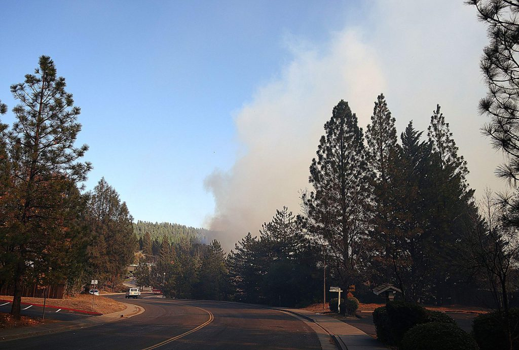 Smoke from the approximately 15 acre Dorsey vegetation fire, billows into the air Sunday afternoon in Grass Valley.