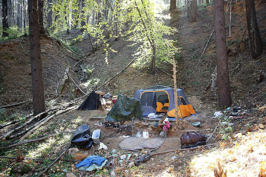 One of two subjects arrested Tuesday night is accused of having an open pit fire at this illegal encampment on a portion of the Loma Rica Ranch off Idaho Maryland Road. The city of Grass Valley has taken a no nonsense approach to illegal encampment fires during the high fire risk season.