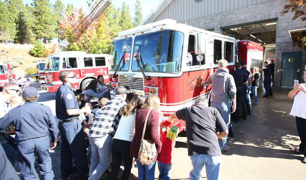 Friends, family, and fellow first responders helped to push in the brand new Engine No. 2 at Grass Valley Fire Station No. 2 Saturday morning.