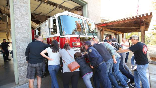 Grass Valley firefighters and their extended first responder family and friends, helped to christen Grass Valley's new engine No. 2 with a wet down and push in ceremony held Saturday morning at Fire Station No. 2.