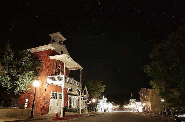 The historic Broad Street fire house in Nevada City, along with the rest of downtown, stayed illuminated through the night with the help of the gas powered street lamps.