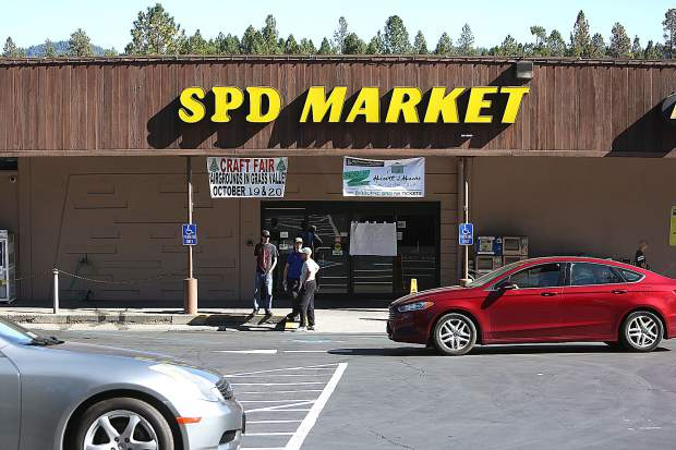 SPD Market in Nevada City was closed Thursday due to the PG&E power shutdown, though many showed up to scavenge through 75 shopping carts full of discarded perishables.