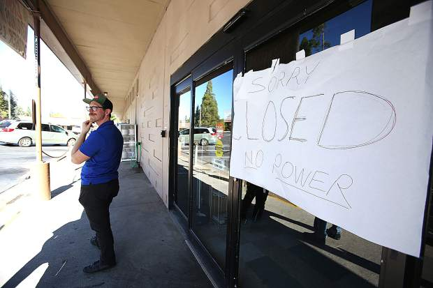 An SPD Market employee stands outside of the Nevada City store letting customers know that they are closed due to the shutdown Thursday afternoon.