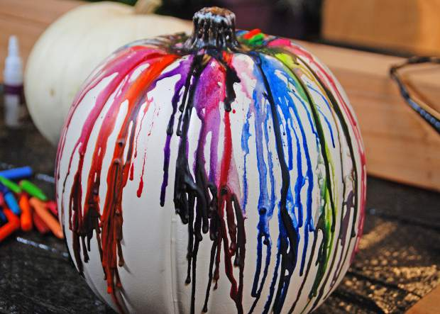 Make use of extra crayons by creating a unique and colorful crayon dripped pumpkin.