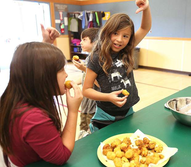 Second graders were asked to give either a thumbs up or down following a taste test of their hand made locally sourced tater tots.