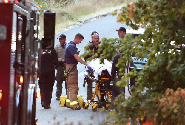 An individual injured during a foot chase is placed on a stretcher and in an ambulance on Granholm Way, off Pittsburg Road, following Wednesday evening's suspicious vehicle chase.