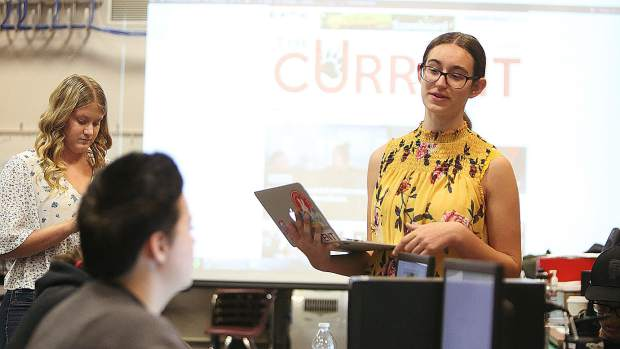 Sonora Slater, executive editor of Bear River's student newspaper The Current, talks to members of the high school newspaper during class. Slater has won multiple awards for her work as a student journalist.