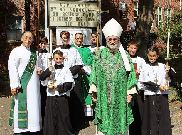 Among those celebrating the 160th anniversary of Mt. St. Mary Academy were, from left, Richard Soria, deacon, Saint Patrick Church; Niko Palacio, altar server, student at Mt. St. Mary's; Aidan Mabry, altar server, student at Mt. St. Mary's; Evan Mc Daniel, altar server, Mt. St. Mary's Alumn; Father Alex Estrella, Saint Patrick Parish priest; Luke Billingsley, altar server, student at Mt. St. Mary's; Bishop Jaime Soto, Sacramento Diocese; Thomas Billingsley, altar server, student at Mt. St. Mary's; and Jack Mc Daniel, altar server, student at Mt. St. Mary's.