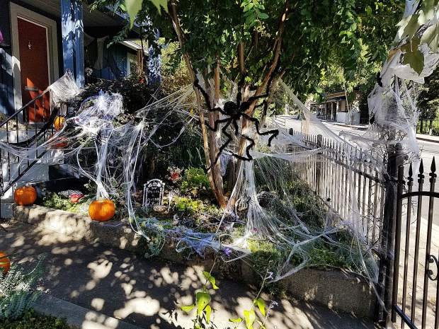 The front yard of the Poston family's home is filled with skeletons, goblins, giant spiders, rats, gravestones, witches and too many other Halloween decorations to list.