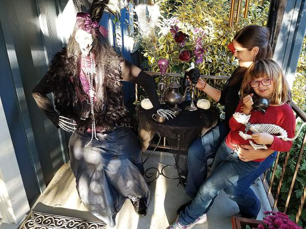 Maggie Poston, who just celebrated her 7th birthday, helped her mother Elizabeth design and decorate for Halloween the Poston family home on Main Street.