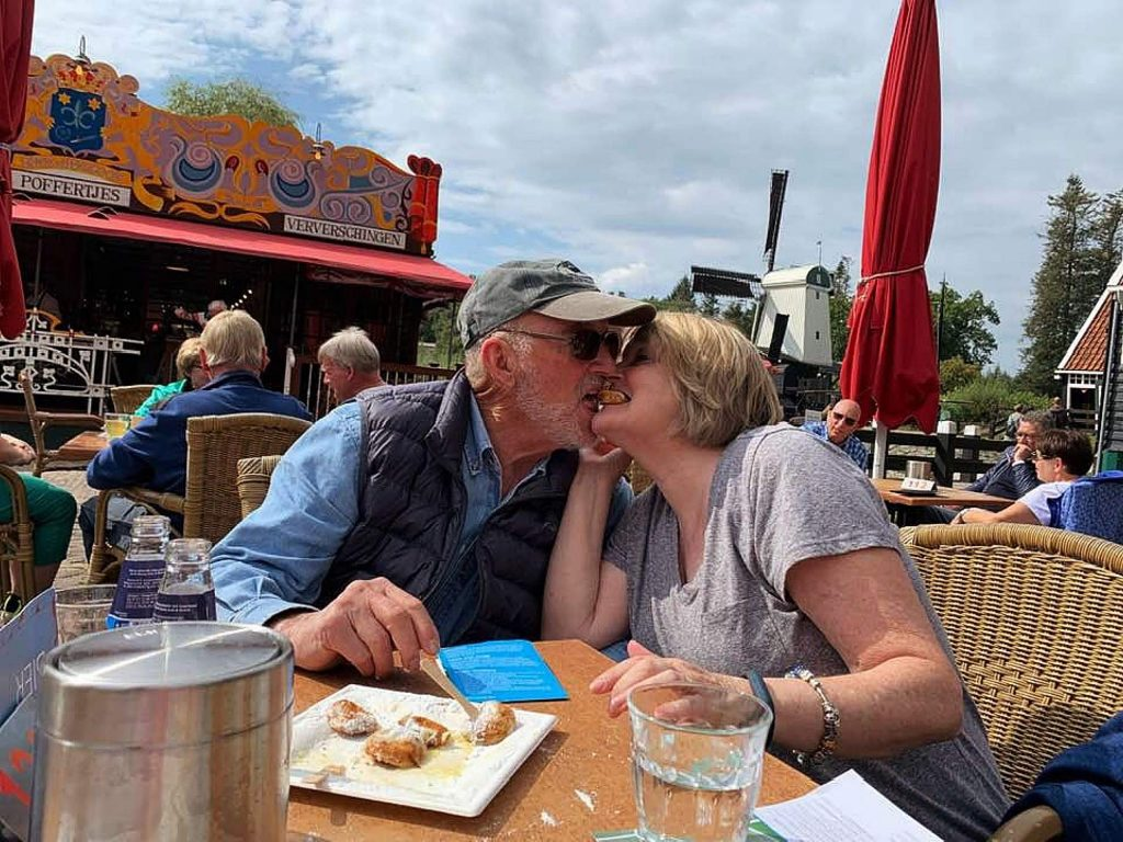 Gordon and Lindy Beatie share Poffertjes, traditional Dutch mini pancakes, at a café at the Open Air Museum in Arnhem, Holland. The museum honors the everyday lives of Holland's people with antique houses, farms and factories from different parts of the country.