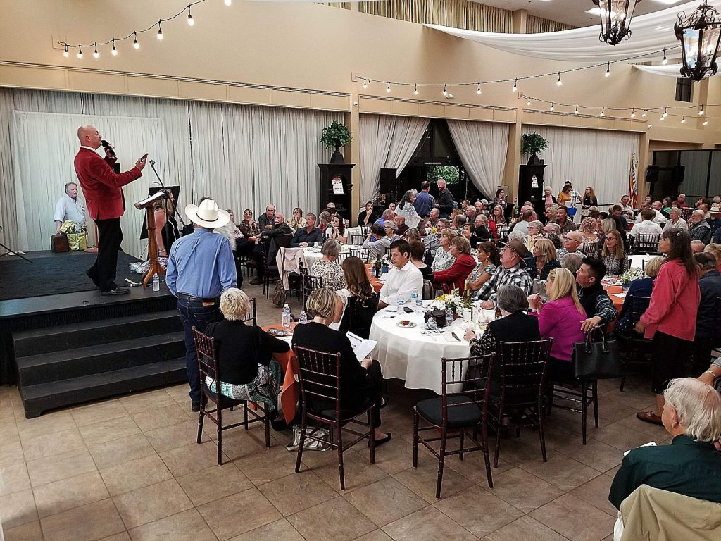 Gary Lorentzen, shown here at the Nevada County Habitat for Humanity 'Street of Dreams; fundraiser, is a certified Benefit Auctioneer Specialist who conducts live auctions for a variety of local nonprofits.