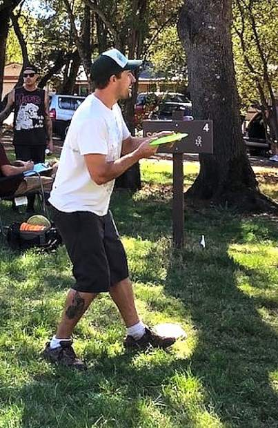 One of the many fun events at the United Way's 12th Grills & Grilles fundraiser at Western Gateway Park will be the Fifth Annual Derek Sorenson Memorial Disc Golf tournament. In this photo, John Barsby competes in a previous disc golf tournament doubles competition.