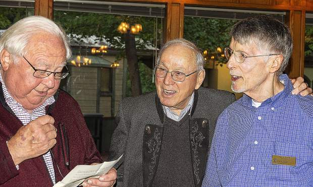 Rudy Cisar, left, reads information about Rolf Laessig, center, who received the Lifetime Achievement Award from the Nevada County Historical Society at a Sunday ceremony. David Bard, the group's treasurer and Sunday's master of ceremonies, is right.