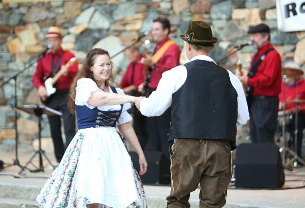 Folks dressed in their favorite Oktoberfest attire and danced the night away to the band Road Test during Saturday night's event at Pioneer Park to benefit the Kare Crisis Nursery.
