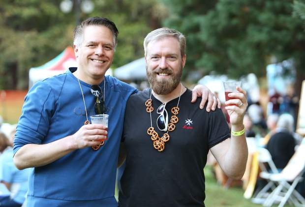 Midtown Sacramento's Matt Martinez and Ted Russert enjoy some brews at Pioneer Park Saturday evening. The two have been coming to the Kare Crisis Nursery's Oktoberfest for the past 27 years.