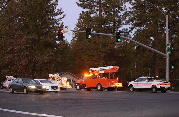 Caltrans workers help to keep the signal lights on at the intersection of Highway 49 and La Barr Meadows Road.