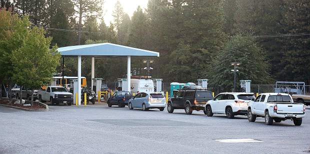 Lines back up at the Robinson Gas Station off of Lower Grass Valley Road in Nevada City, one of the only area gas stations to continue pumping through the power shutdown.