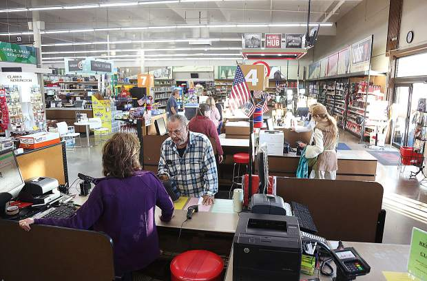 Customers shop at B&C Ace Hardware in the Glenbrook Basin where a generator kept the lights on. Their gas powered generators for sale had been depleted though.