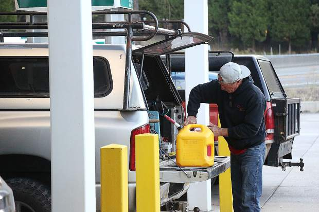 Gas customers fill up their extra gas cans after filling up their vehicles Wednesday morning at the Robinson Gas Station off of Lower Grass Valley Road in Nevada City.