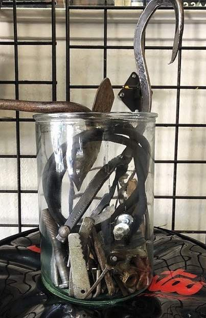 A jar of items found in tires at Plaza Tires in Nevada City.