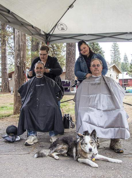 Stylists from Great Clips giving free haircuts to Veterans.