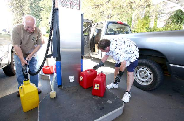 People like Rattlesnake Road resident Lloyd Nelson, right, could be seen filling up their gas cans among lines of others in Grass Valley's Glenbrook Basin, waiting to fill up their tanks in advance of a potential PG&E power shutdown.