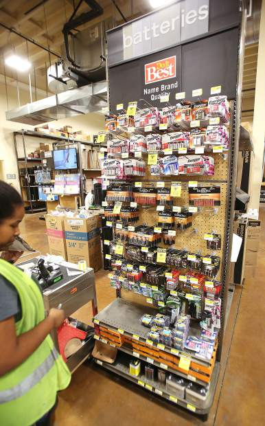 Hills Flat Lumber staff take inventory and stock their battery selection accordingly. The store will remain open during the shutdown, with plans to keep the cafe open this time.
