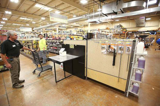 Employees at Hills Flat Lumber hardware store in Grass Valley show the empty space where their selection of gas generators continues to sell out shortly after their selection comes Tuesday afternoon.