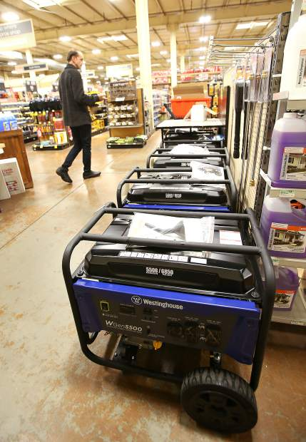 Nevada City author Arjuna Ardagh checks the different generators that Hills Flat Lumber hardware store stocked Tuesday evening at the Grass Valley location off Railroad Avenue in preparation of the potential PG&E shutoff planned for today and Thursday.