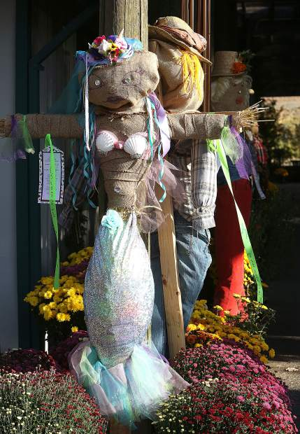 A mermaid scarecrow is displayed with a 'sold' sign Tuesday afternoon at Weiss Brothers Nursery in Grass Valley.