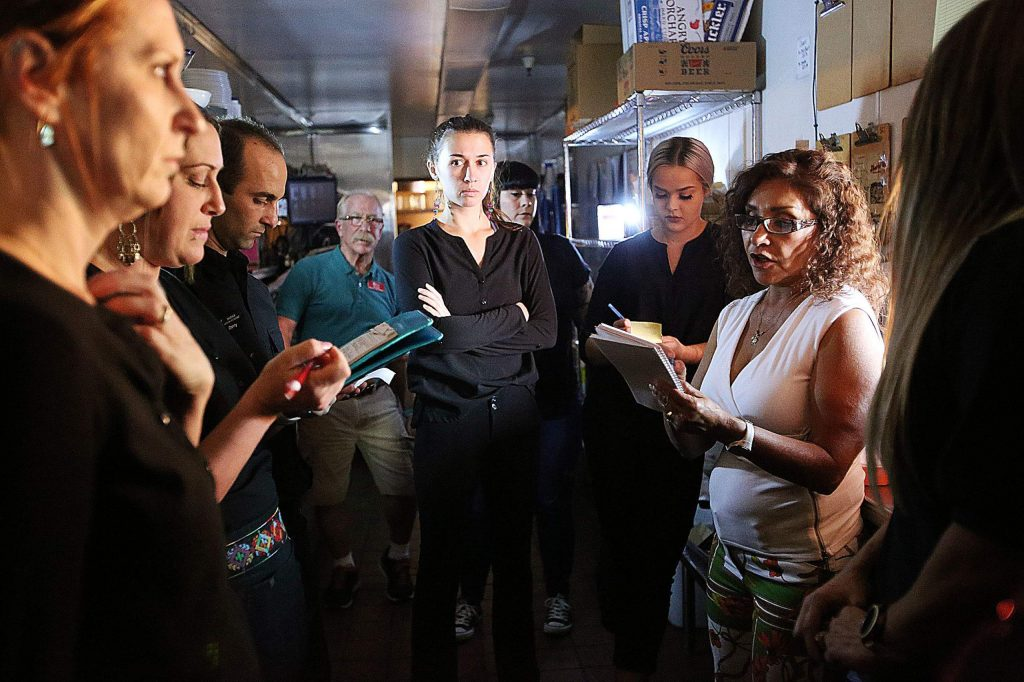 Maria's restaurant owner Maria Ramos-Byers talks to her employees about the limited menu they will be offering to customers during efforts to keep the restaurant open following the third PG&E power shutdown to hit Nevada County over the past month. Business owners are finding ways to keep open with generators and battery power.