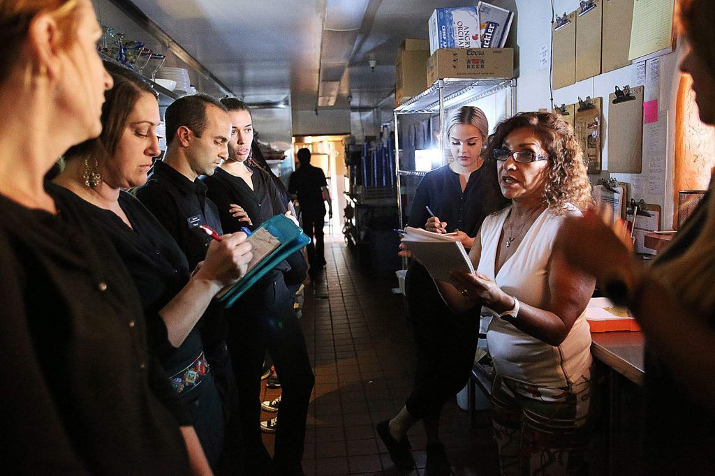 Maria's restaurant owner Maria Ramos-Byers talks to her employees about the limited menu they will be offering to customers during efforts to keep the restaurant open following the third PG&E power shutdown to hit Nevada County this past fall. Business owners found ways to keep open with generators and battery power.