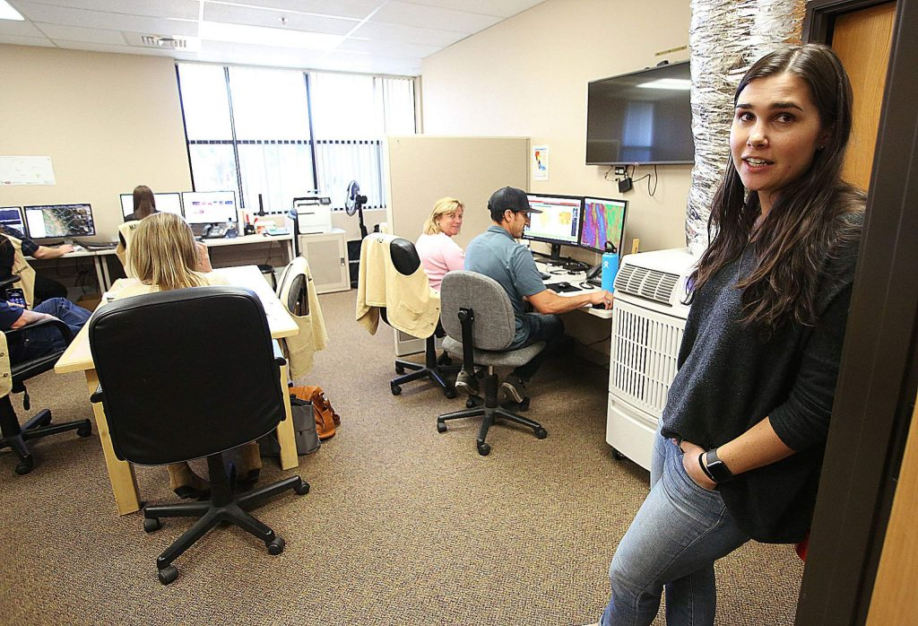 Taylor Wolfe, administrative analyst for the County Executive Office, stands in the entryway of the Emergency Operation Center at the Eric Rood Administrative Center in Nevada City.