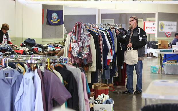 Roy Baker, who served in the U.S. Army, peruses some of the clothes made available during the All Veterans Stand Down Friday at the fairgrounds.