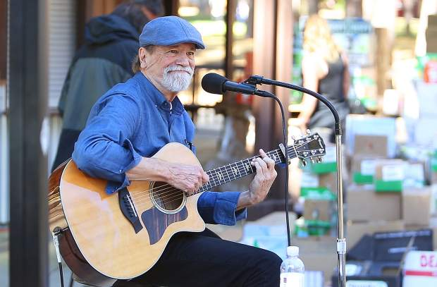 Singer songwriter Chris Crockett helps to provide a peaceful ambiance with his selection of songs played Friday during the Stand Down benefit at the Nevada County Fairgrounds. The event continues today.