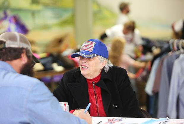 All Veterans Stand Down volunteer Sue Carmichael checks in vets Friday afternoon at the Nevada County Fairgrounds so that they can take advantage of the many services brought under one roof.