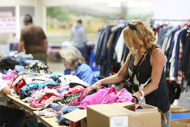 U.S. Army veteran Colette DeRossett peruses some of the clothes made available during All Veterans Stand Down Friday. The event runs through 2:30 p.m. today.