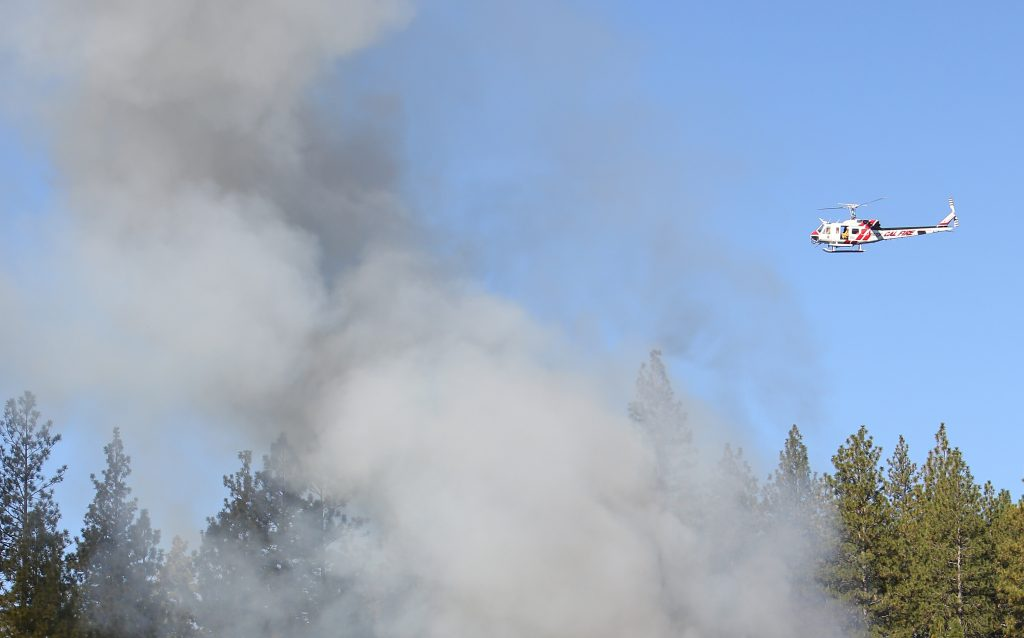 A Cal Fire helitack copter was briefly called to defend the surrounding wildland from the Personeni structure fire.