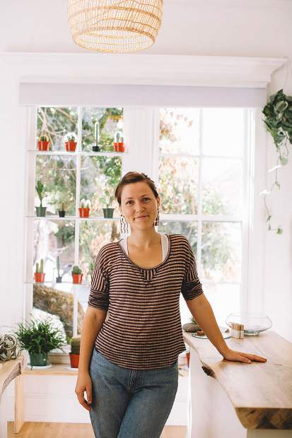 Leiya Mahoney standing in her shop, The Sunroom, which she recently opened.