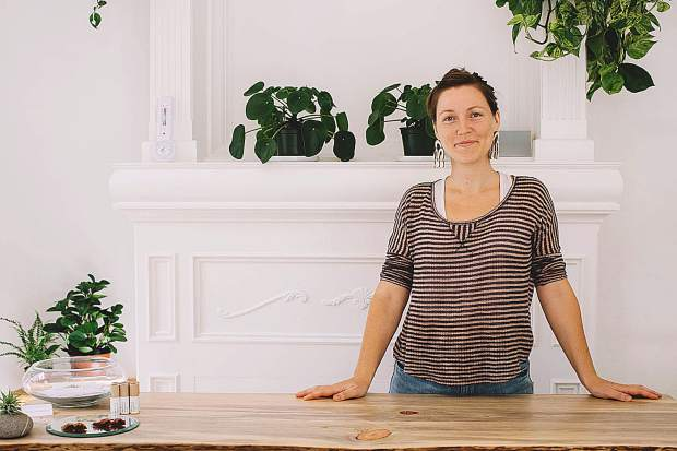Leiya Mahoney in her store. Mahoney put much intention into her shop, which gives the feeling of being outside.