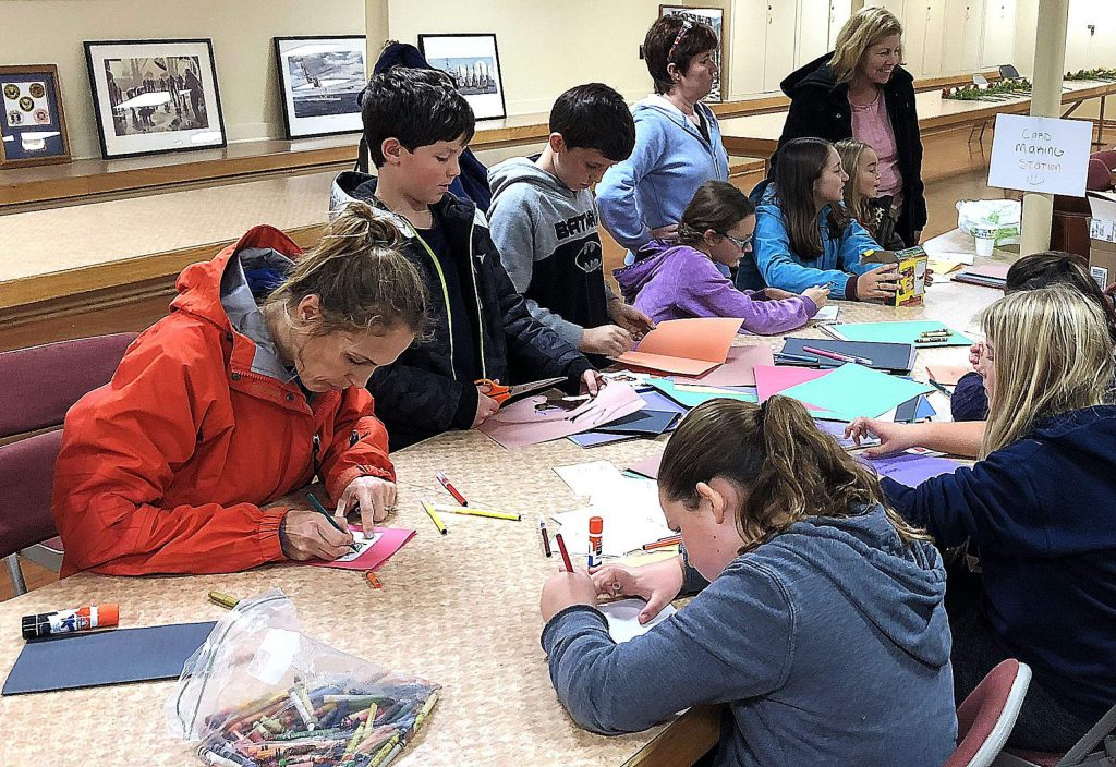 Volunteers make cards to be delivered with meals last year for Thanks to Give.